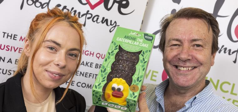 Danika and Mike Woods from Just Love Foods with Archie the caterpillar cake